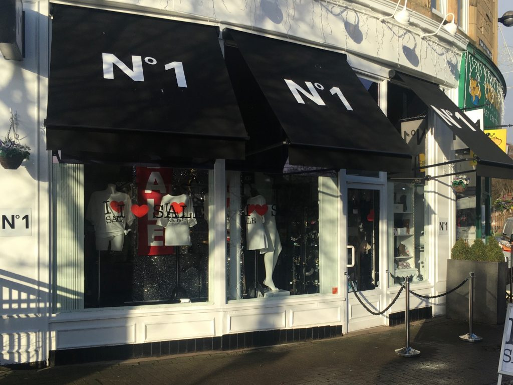 no.1 boutique shop displaying canopies and sale in windows